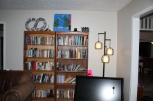 The overcrowded bookshelves that needed to be rearranged.